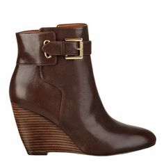 """Almond toe bootie with buckle detail. Single sole 3 1/4"""" wedge bootie. Full zipper closure. Leather upper."""