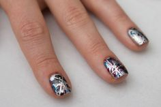 graffiti: silver base, make geometric shapes with striping tape, then use a straw to splatter each nail with different colors. peel off tape and add a thin glitter topcoat.
