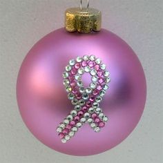 "Peony Pink Breast Cancer Awareness Ribbon Ornament  I think these would be easy to make rather than spend so much money. Swarovski has all kinds of crystals that you could easily transfer the crystals onto a pink ornament.   ""Breast Cancer Awareness pink ribbon Christmas tree ornament with authentic crystal and pink Swarovski rhinestones."""