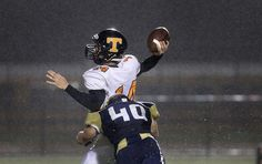 Tabb quarterback Alec Kurek is hit by Matt Hummel of Lafayette as he tries to throw during the second quarter Thursday.