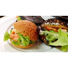 Mini sesame pacman burger with grilled salmon and some vegetable in salad packs.  This meal for dad and mon.  Mini sesame burger from breadtalk.
