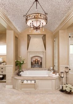 I like the bathroom just fine, but I love the drawer for towels under the tub! And the idea of a fireplace