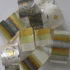 Striped Ribbon Cuffs | Contemporary Bangles by contemporary jewellery designer Jessica Briggs