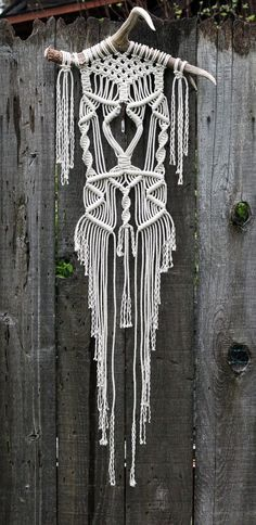 Macramé wall hanging on large deer antler with quartz crystal point
