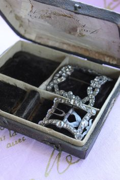 18th century French paste shoe buckles,tucked in a velvet lined box
