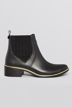 12 Rain Boots That Could Totally Pass For Office Shoes #refinery29  http://www.refinery29.com/cute-rain-boot-shoes#slide-7  No need for a change of shoes: These sleek, rubber Chelsea boots will survive your rainy commute and a full day at the office.