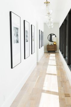 Do you to make your long narrow entryway or hallway appear bigger? These narrow entryway ideas will help your entryway make a strong first impression. Hallway Wall Decor, Hallway Walls, Upstairs Hallway, Hallway Lighting, Hallway Ideas Entrance Narrow, Modern Hallway, Hallway Console, Corridor Ideas, Entryway Ideas