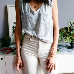 Light gray sleeveless top and cream pants. Image via The Transatlantic
