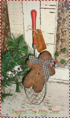 Could do with kitchen utensils like wooden spoons to make look old.  Add a gingerbread man and tag.