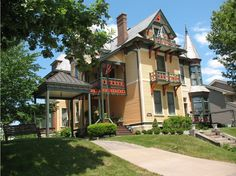 2011 Great Places in America: Neighborhoods-Gold Coast & Hamburg Historic District, Davenport, Iowa.  Spectacular vistas, superb architecture, and active residents distinguish the Gold Coast-Hamburg Historic District, among Iowa's oldest residential neighborhoods. Bluffs overlooking the Mississippi River afford unsurpassed views of the water. Lining the neighborhood's streets are some of the city's largest and most opulent houses, built between 1840 and 1910 by the majority of German citizens.