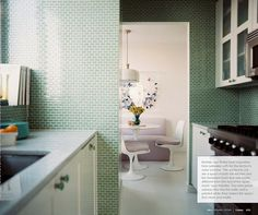 mint green is seriously my favorite color. this kitchen is so gorgeous.