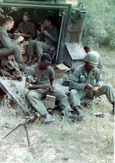 Soldiers of the 5th Mech. Inf., 25th Inf. Div. eat C-rations on the ramp of a M113 during Operation Cedar Falls, 1967. ~ Vietnam War