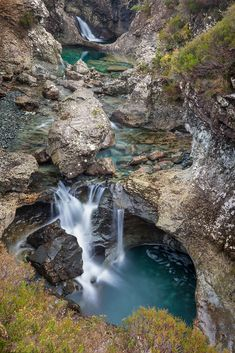 Waterfalls in the Fairy Pools in the midst of the Isle of Skye's Cuillin Mountain range.