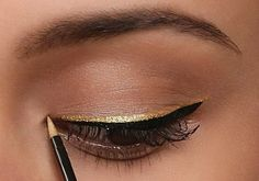 Gold and black layered eyeliner look #makeupideas #eyeliner