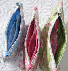 2 in 1 Zippered Pouch. Add a matching card wallet, use the inner zip for coins,  great wallet.
