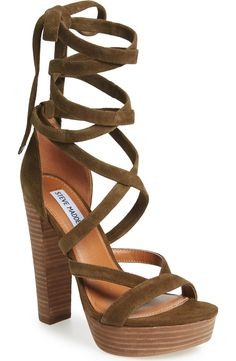 A lofty stacked heel and platform amplify the retro vibe of this standout lace-up suede sandal from Steve Madden.