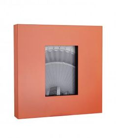 Free standing on a side table or hung on the wall, this orange 5-by-7-inch frame will add a bit of colorful pizzazz without the commitment of a statement wall. This frame is also available in a subtle metallic copper.