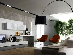 Contemporary vs. Modern Style: What's the Difference? Today's contemporary style eschews sterile, stark environments (which ultra-modern spaces can sometimes lean toward) and instead embraces stylish comfort. Aesthetic functionality of contemporary spaces include, but are certainly not limited to, soft rugs or floor coverings, throw pillows and blankets, and interesting and artistic accessories.
