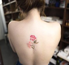 Red rose and lily tattoo on the back.