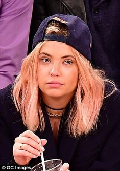 Pinky Little Liars!Ashley Bensondebuted her new pink locks while sitting courtside at the New York Knicks vs. Washington Wizards basketball game at Madison Square Garden on Thursday