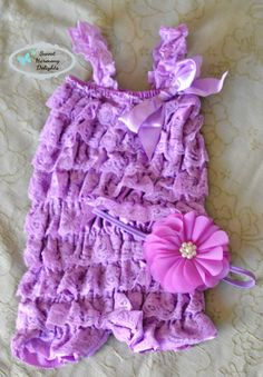 Beautiful purple petti romper set with a matching floral headband on a thin elastic band. Petti romper is sized small to suit from newborn to