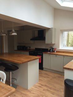 Open plan kitchen; Amersham grey units, solid oak worktops, pendant lighting and velux windows