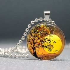 Autumn Tree Under the Sunset,  Altered Art Pendant, Photo Pendant, Glass Dome Pendant with Ball Chain - no. 084-23. $8.95, via Etsy.