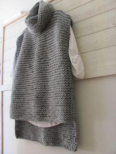 Easy Knit Sweater -- 3 rectangles. Size 10 needles. 47 stitches for all pieces. Longer in the back. Crochet hook seam.