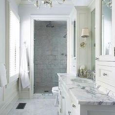 Lynn Morgan Design - bathrooms - blue master bathroom, master bathroom, faceted chandelier, clear glass chandelier, blue paint blue walls gl...
