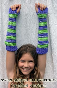 Sweet Striped Crochet Armwarmers: (free pattern)... made these rainbow to match the scarf, added a thumb, and flower felt buttons by the wrist for cuteness!