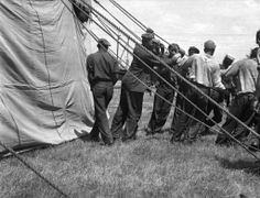Workers Guying out Big Top :: Guying out the big top. This is done to stretch it as it dries during the day. Wallace Bros. Circus, July 4, 1937.