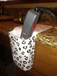 Protect your counter tops from heat and look good doing it! Decorate your Hot Iron Holster with puff paint & Holster on hotties!