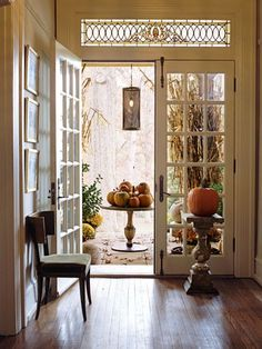 Love the french doors and the window above! (Pedestle table is cute too!