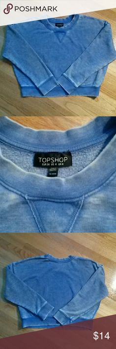 Topshop Cropped Sweatshirt - Nice Denim Blue Color Topshop cropped sweatshirt in a worn denim blue color. Size 4. Made to look like an old comfy sweatshirt (and it is super comfy!) Inside is a soft fleece. Topshop Tops Sweatshirts & Hoodies