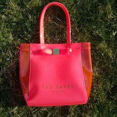 "Ted Baker Coral Tote with Bow Ted Baker Coral tote.  Almost neon pink, very cute and girly ? Waterproof material, perfect for beach or pool! Used, but is in great condition.  12"" W x 10"" L x 4"" d  7"" handle drop  Offers welcome! Ted Baker Bags Totes"