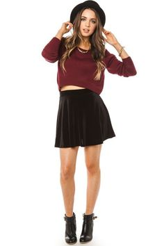 Cropped sweater, skater skirt, booties, and a fedora.