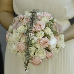 Wedding bouquet with pink, white and pale purple roses, ceropegia. Diamonds and silver string hearts. #wedding #flowers #bridal #bouquet #roses