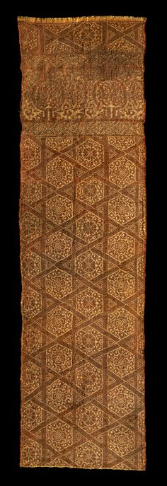 Fragment of a lampas-woven textile, silk and gilded lamella of animal substrate both spun around a silk core and woven flat Eastern Islamic area; mid-13th century