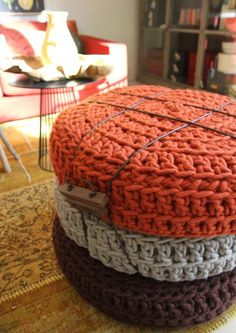 I like the three stacked crocheted ottomans.  Would look great in the tv room!