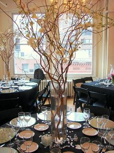 Vintage Style Table decoration - If you add butterflies or snowflakes or minilights to the branches, do each table in the SAME colour. Keep the theme simple, but don't skimp on the butterflies etc. Make it pop.