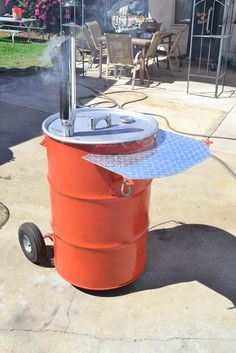 From my Flickr pages. Building a Pit Barrel Smoker, aka ugly drum smokers.