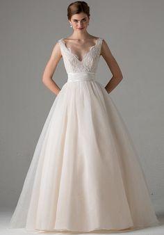 A classic A-line sleeveless dress with a scalloped lace V-neckline, cummerbund waist, and full organza skirt.