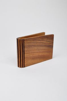 Margiela Wood Wallet. Don't know about comfort, but certainly out of the ordinary
