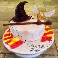 Harry Potter themed birthday cake. I tried to make the cake look like the marauders map and all parts of it were edible… the sorting hat and golden snitch were made from fondant, Rice Krispie Squares and spaghetti!!!