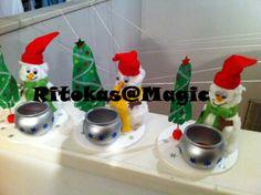 Prenda de Natal (sala 2 anos)- Porta velas - Boneco de neve - embalagem de iogurte liquido forrada com algodão cachecol e gorro restos de feltro; Porta velas - embalagem de iogurte pintado; Pinheiro - pintura do pé da criança