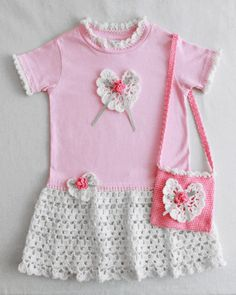 An easy way to make a crochet dress for your little girl is using the Rose T-Shirt Dress and Purse pattern. A pretty pink t-shirt serves as the base for this dress. You add a crochet skirt, neck and sleeve edging and a pretty heart with rose embellishment. You can even make a matching purse so she has a place to store her little treasures when you are on the go. Your little girl will love this dainty little T-shirt Dress and matching purse, and may never want to take it odd. The crochet sh