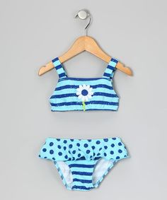 Sugar, spice and all things nice went into this sunsational swimsuit. It's abuzz with polka dots and stripes, a big daisy appliqué and a ruffled skirt along the bottom.