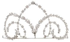 A diamond tiara, of scrolling millegrain floral and foliate design, set throughout with rose-cut diamonds.