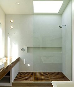 Cool floor treatment. Now knock out that end wall, replace with glass doors to outside shower, and run the floor all the way out of the shower and to the outdoor shower. :)
