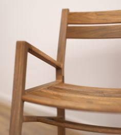 a chair which is made out of oak/walnut for outdoor use.